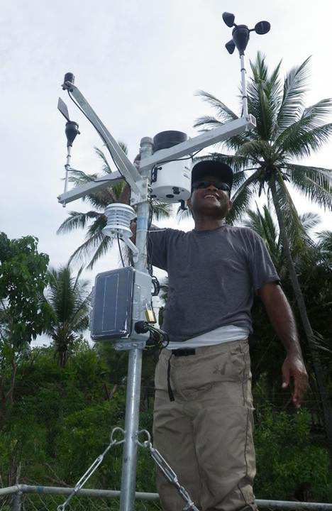 SoL Climate Change Officer Raimundo Mau checks sensors on Atauro Automatic Weather Station