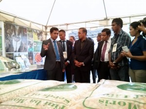 Minister Sabino speaking with the President and MAF-SoL staff at the Seeds of Life stand